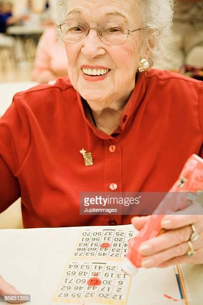 Smiling woman playing bingo