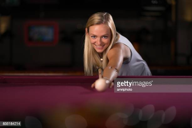 smiling woman playong billiard