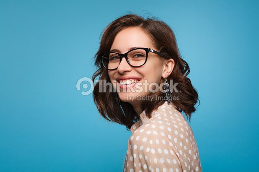 Smiling woman posing in glasses : Stock Photo
