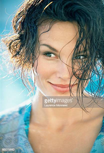 Smiling woman raising eyebrow and looking on side