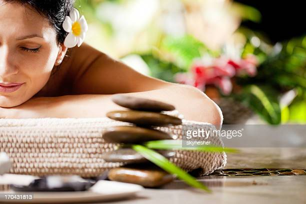 Smiling woman receiving massage at the spa resort.