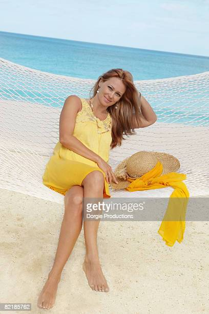 Smiling woman relaxing in a hammock