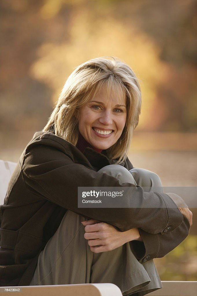 Smiling woman relaxing outdoors : Stock Photo