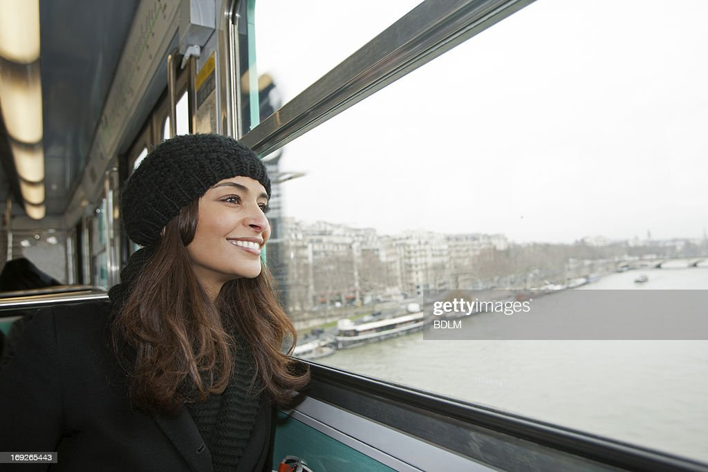 Smiling woman riding train over water