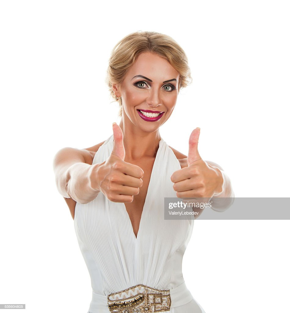 Smiling woman showing tumb sign : Stock Photo