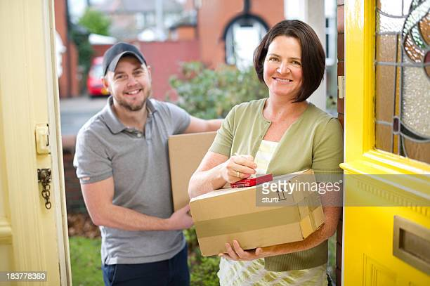 Smiling woman signing for her parcel