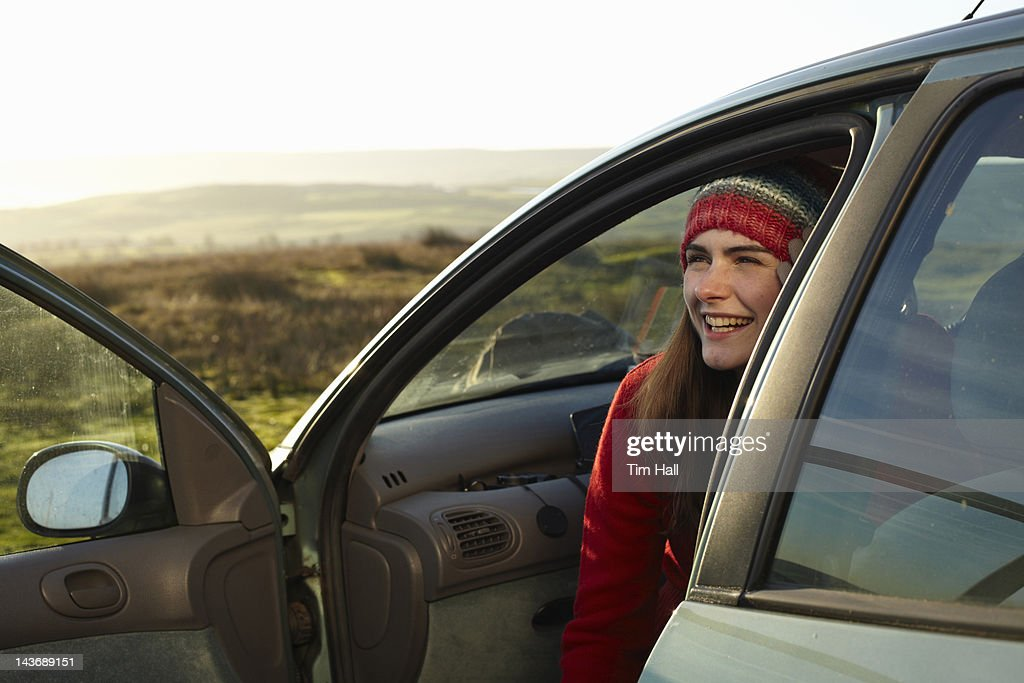 Smiling woman sitting in car : Stock Photo