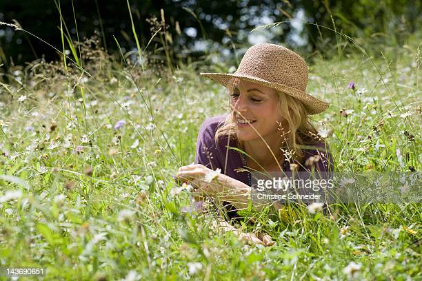 Smiling woman sitting in wheatfield