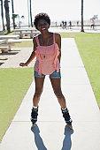 Smiling woman skating in park