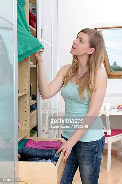 Smiling woman sorting clothes