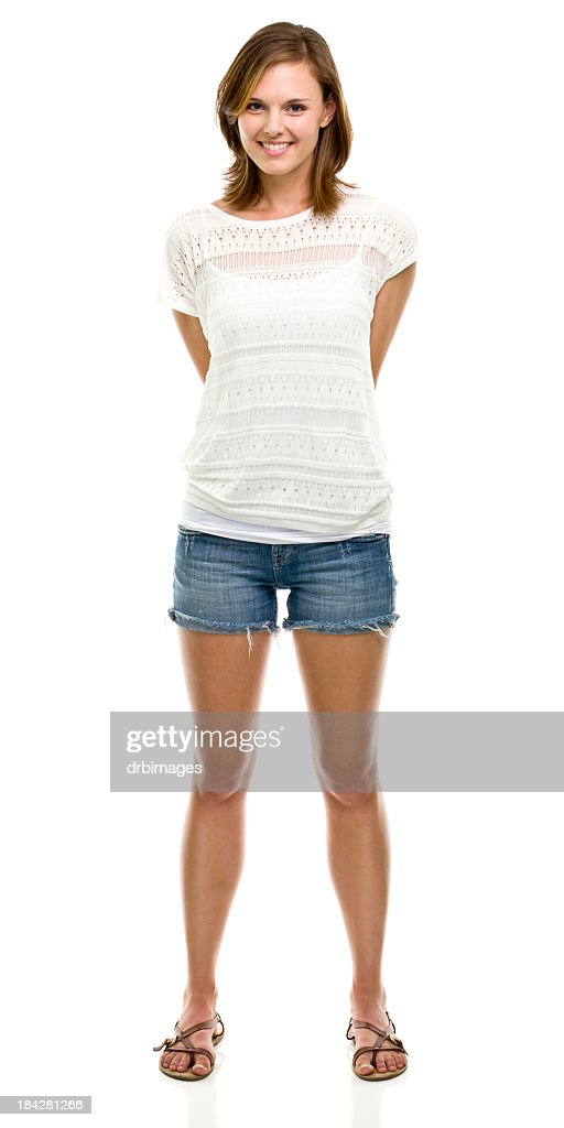 A Smiling Woman Standing Against A White Background Stock ...