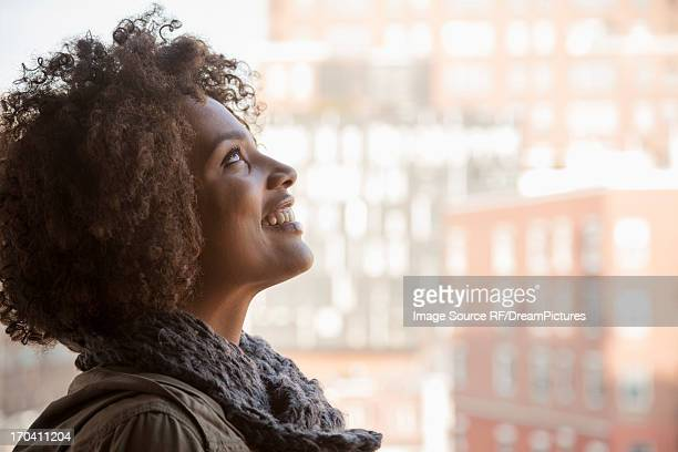 Smiling woman standing at window