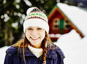 Smiling woman standing in front of cabin