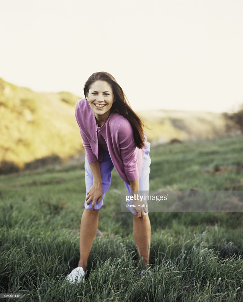 Smiling Woman Standing In Pasture Stock Photo | Getty Images