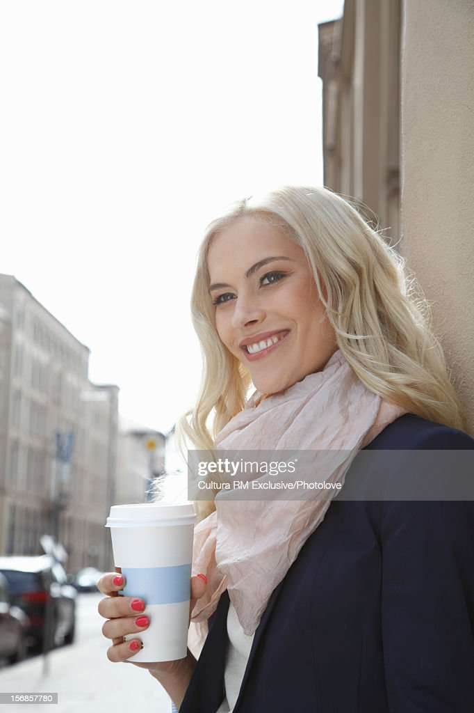 Smiling Woman Standing On City Street Stock Photo | Getty ...