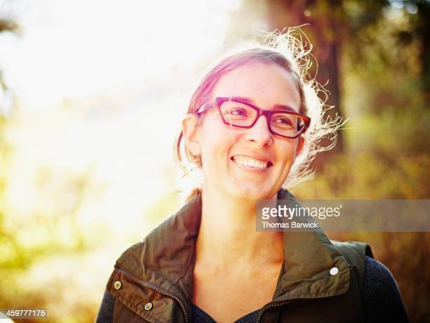 Smiling woman standing outdoors in forest