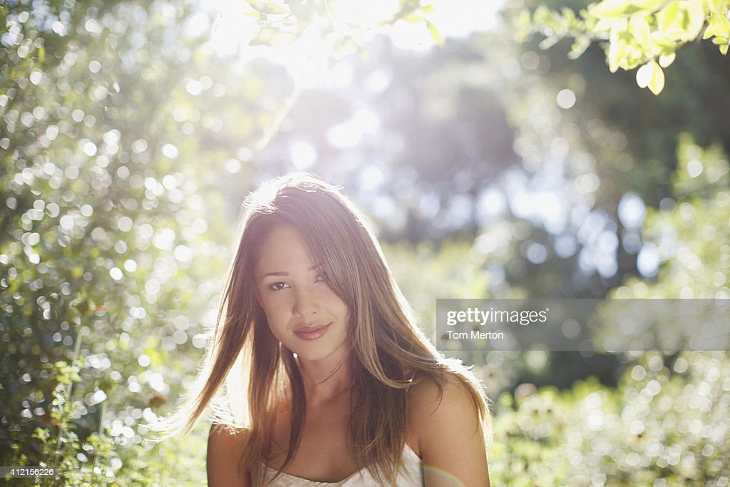 Smiling woman standing outdoors : Stock Photo