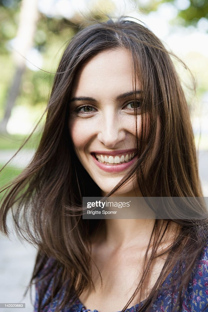 Smiling Woman Standing Outdoors Stock Photo | Getty Images