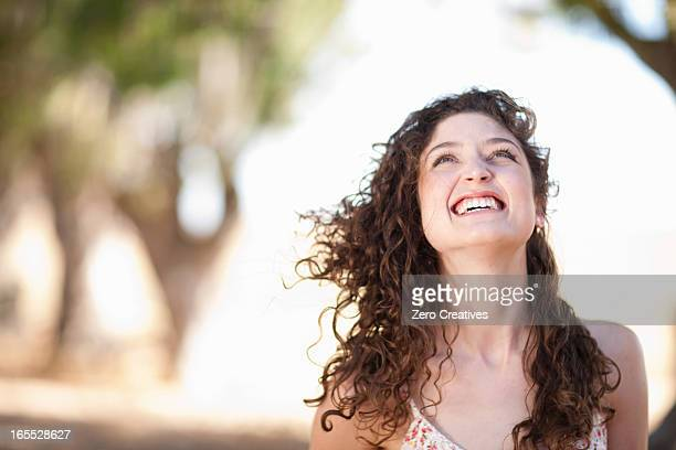 Smiling woman standing outdoors