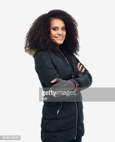 Smiling woman standing with arms crossed : Stockfoto