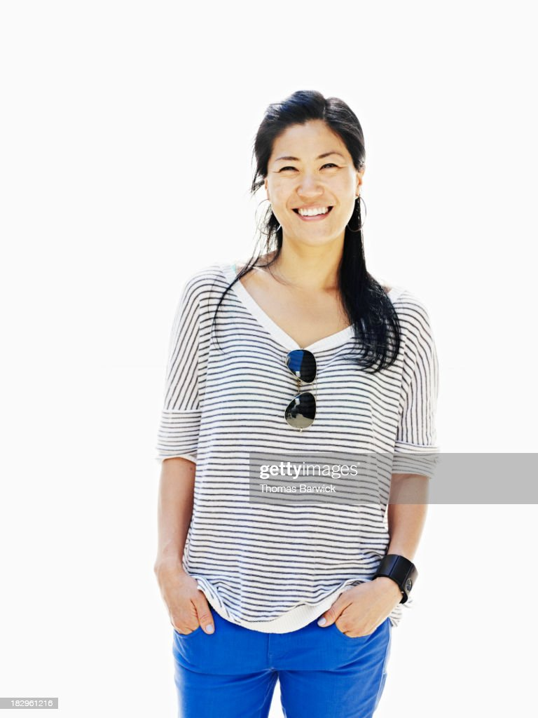 Smiling Woman Standing With Hands In Pockets Stock Photo ...