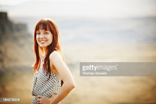 Smiling woman standing with hands on hips