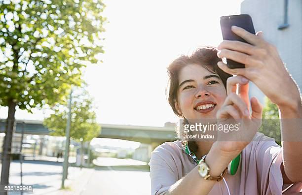 Smiling woman taking selfie