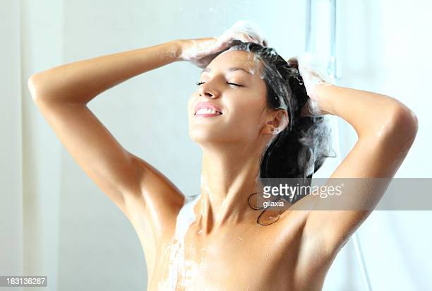 Smiling woman under shower.