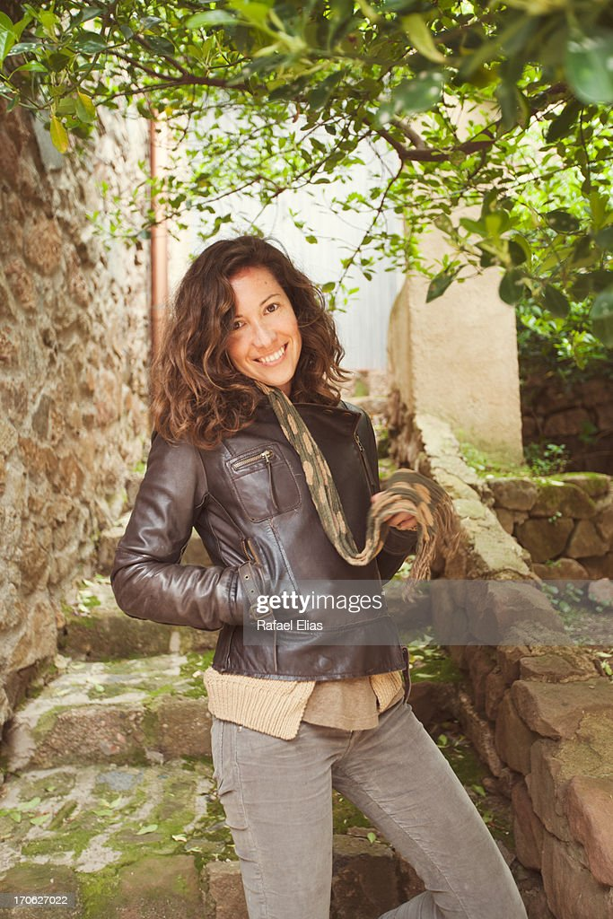 Smiling woman under tree : Stock Photo