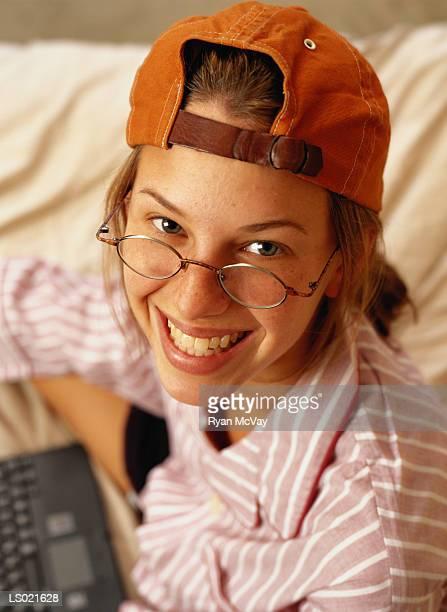 Smiling Woman Wearing a Baseball Cap