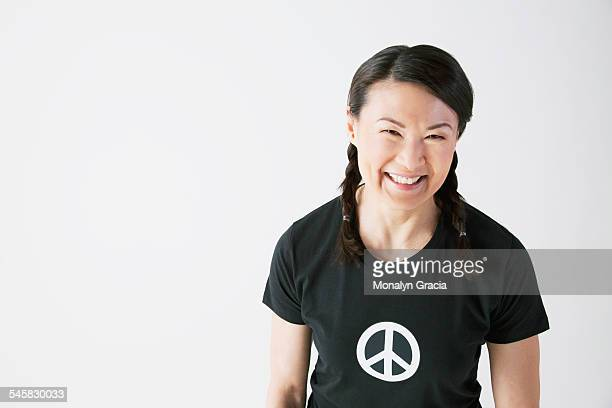 Smiling woman wearing a peace t-shirt