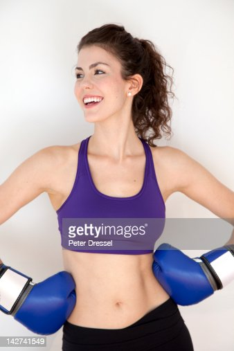 Smiling woman wearing boxing gloves