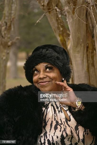 Smiling Woman Wearing Fur Coat And Knit Hat
