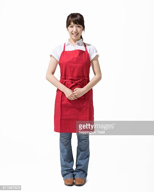 Smiling Woman Wearing Red Apron