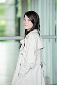 Smiling woman wearing trench coat