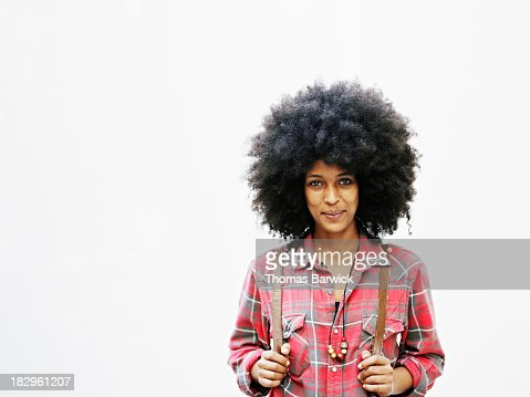 Smiling woman with afro hairstyle