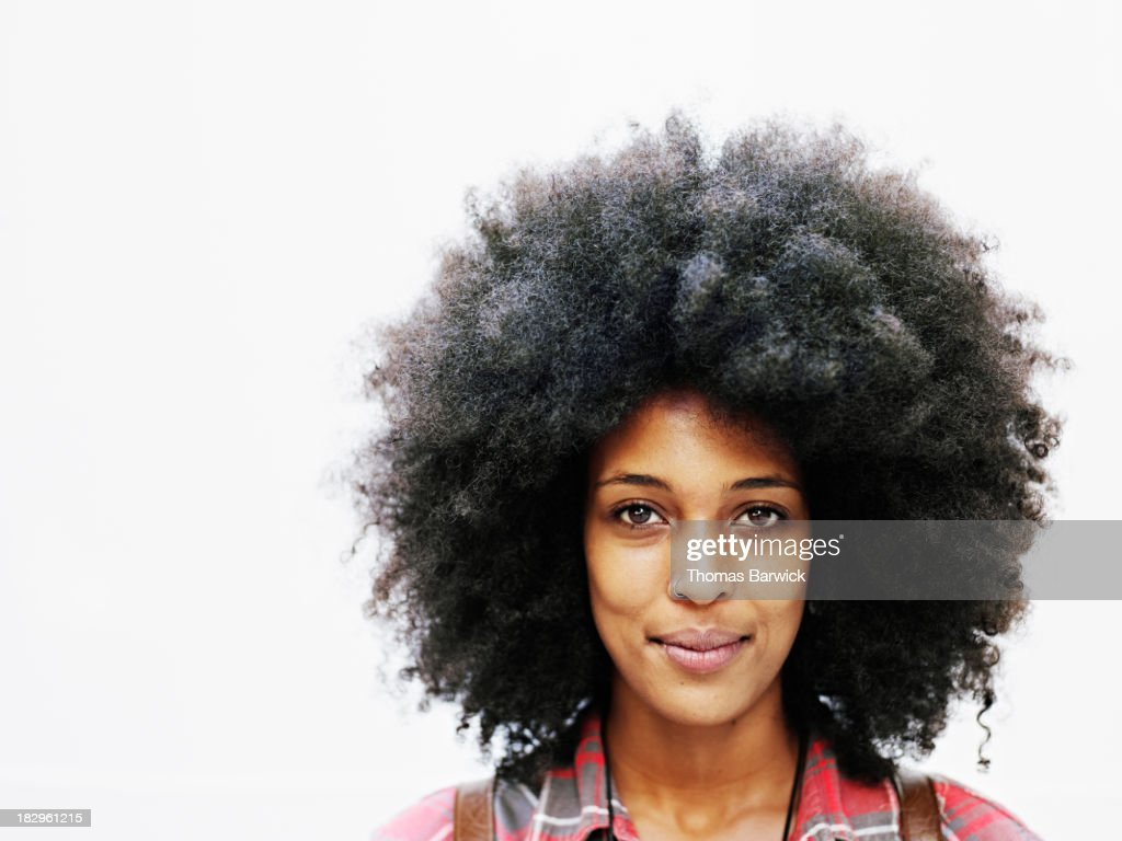 Smiling woman with afro hairstyle : Stock Photo