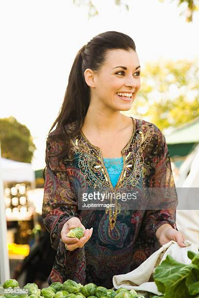 Smiling woman with brussels sprouts