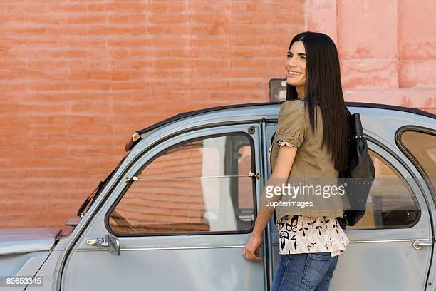 Smiling woman with car