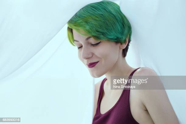 Smiling Woman with green hair under the veil