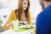Smiling woman with green tea and vegan stir fry