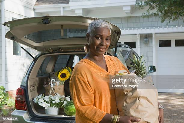 Smiling woman with groceries