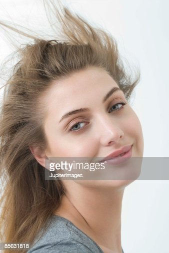 Smiling woman with hair blowing : Stock Photo