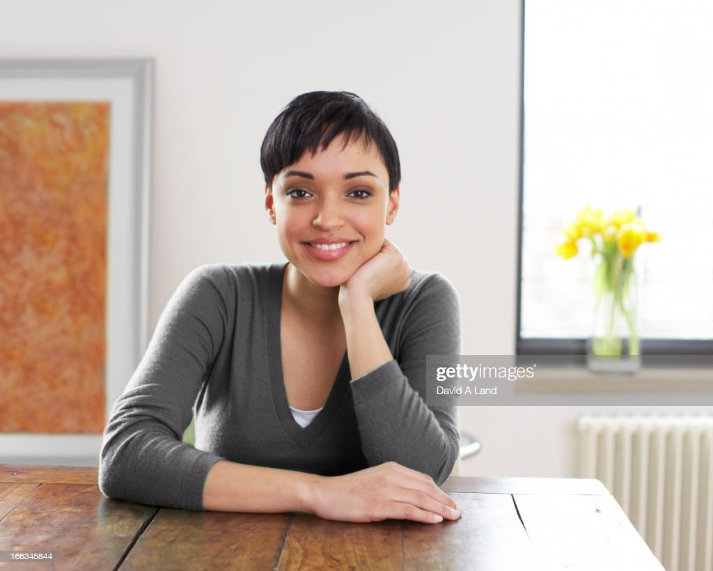 Smiling woman with hand on chin : Stock Photo