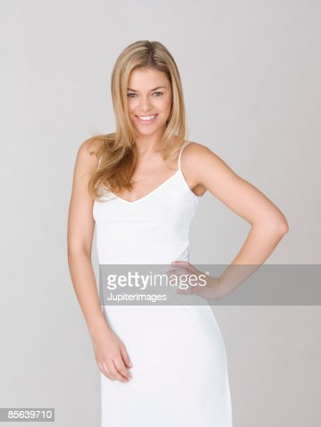 Smiling woman with hand on hip : Stock Photo