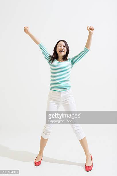 Smiling Woman With Hand Raised