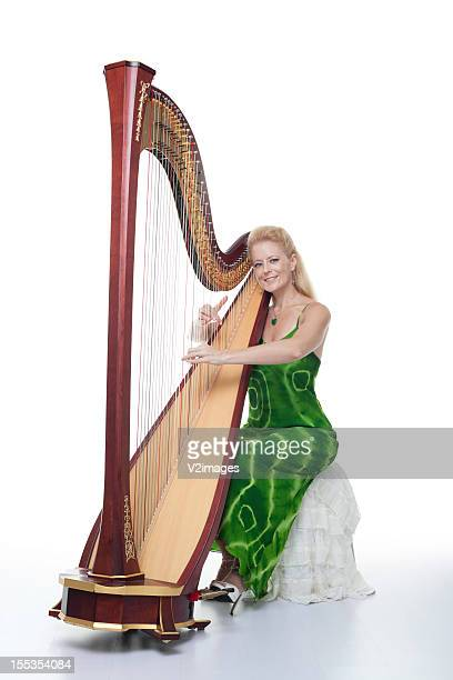 Smiling woman with harp