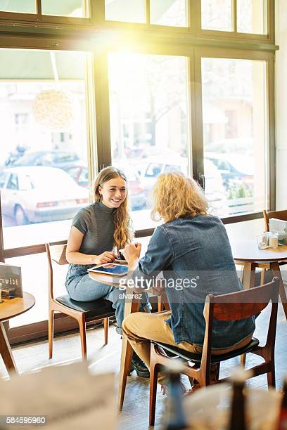 Smiling woman with her boyfriend at cafe