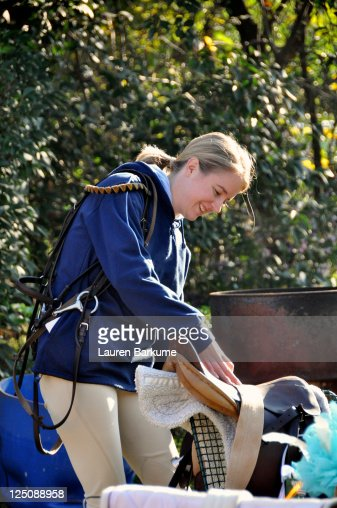 Smiling woman with horse riding clothes