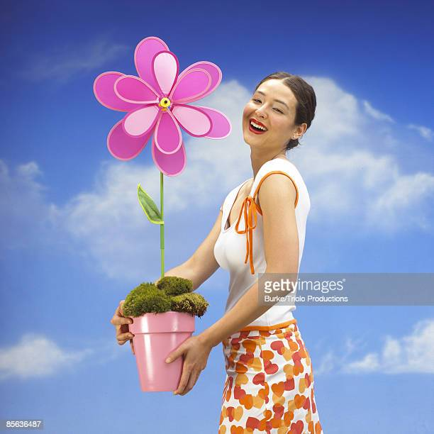Smiling woman with large pink flower